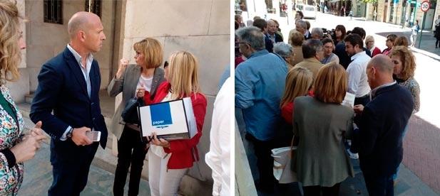 Mario García y la regidora del PP Isabel Miró han arropado hoy a los propietarios de viviendas de primera línea de costa en Nules en su entrega de documentación a la jefatura provincial de Costas.